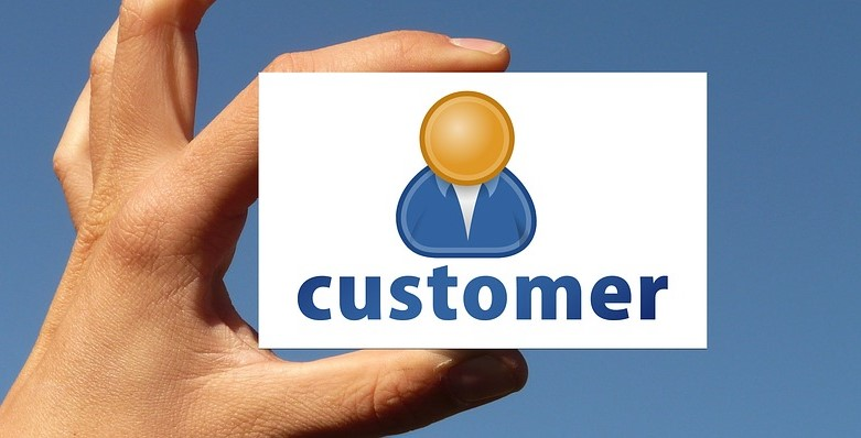 first clients holding a customer business card